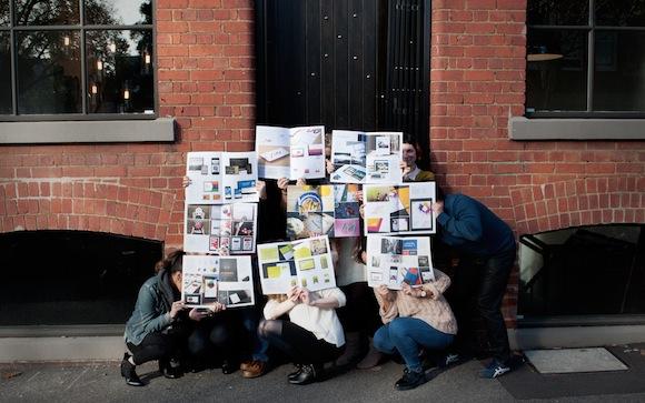 The Yoke team pose with their studio workbook.