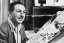 Mr Walt Disney sits at his drawing board in his studio, drawing a sketch of Mickey Mouse